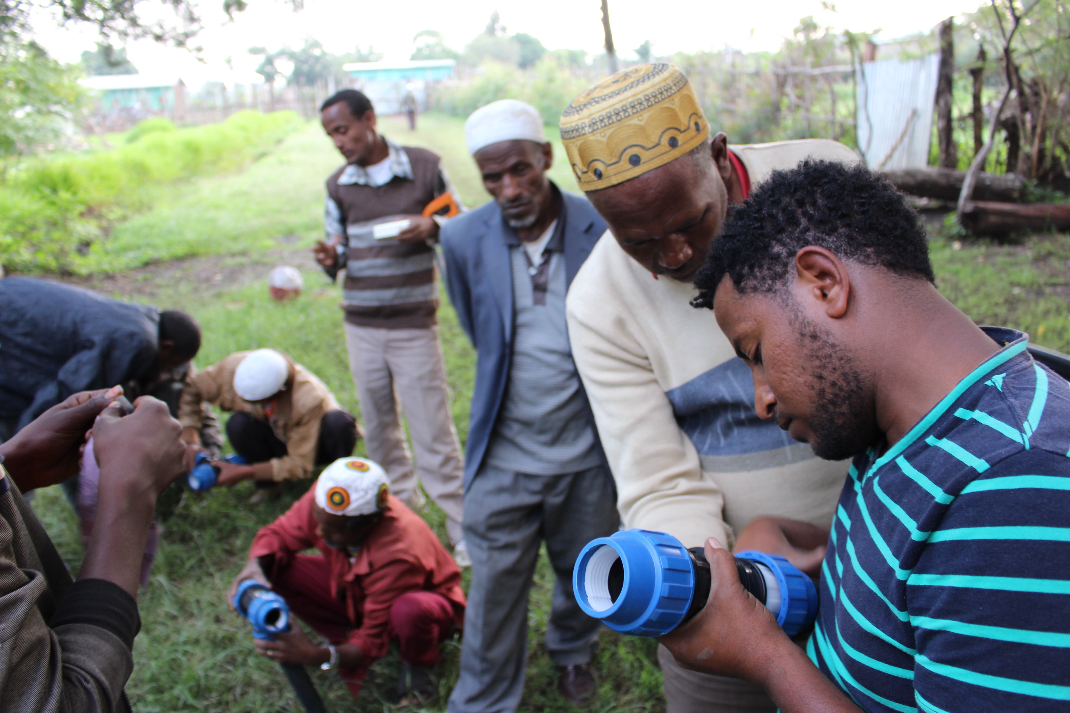 Residents of Wita, a small rural community three hours south of Addis Ababa, Ethiopia's capital, examine infrastructure that will be used to improve the reliability of their water supply. Photo credit: Triple Bottom Line (3BL) Enterprises