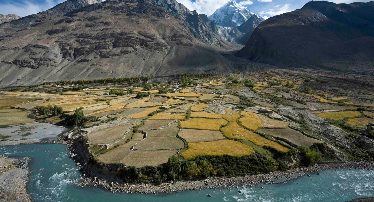 Flood plain cultivation in Wakhan, Afghanistan, in the shadow of the Pamir Mountains. Photo Credit: John Winnie Jr., WCS-Afghanistan