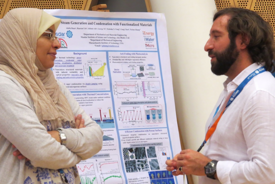 Participants discuss their research at the Arab-American Frontiers poster session. Photo Credit: National Academy of Sciences