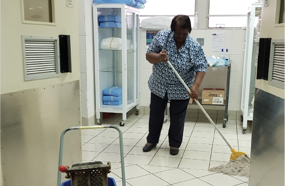 Ms. De Bruin, who has worked as a passionate and dedicated environmental cleaning staff for over 40 years at a hospital in Cape Town, South Africa demonstrates best practices for mopping floors in a patient care area. Photo credit: CDC
