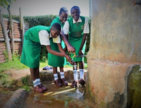 Kenyan girls washing hands