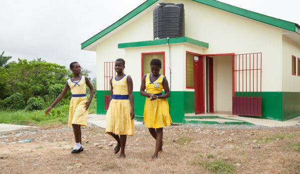 Schoolgirls in Ghana exiting a new toilet facility, made possible by the Improved WASH in Ghana project by the Water and Development Alliance (WADA). Photo credit: WADA