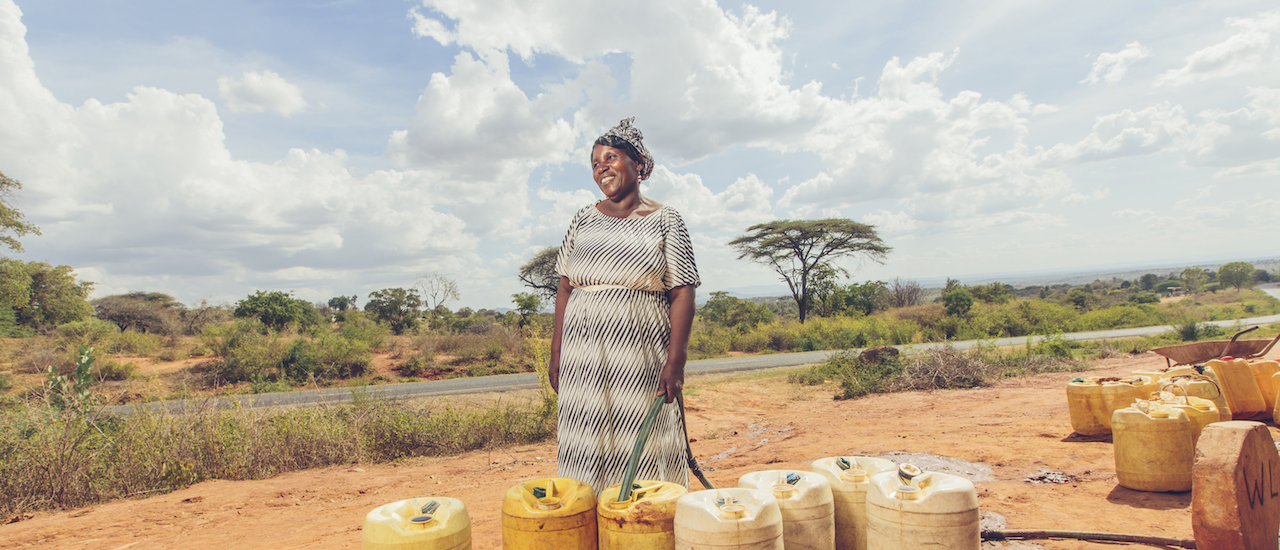 Enjoying improved water access in Kenya. Photo Credit: Bobby Neptune for USAID