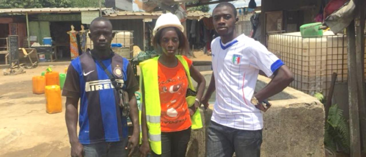 Judith poses with two of her colleagues at a construction site in Abidjan. Photo credit: Olivier Konan