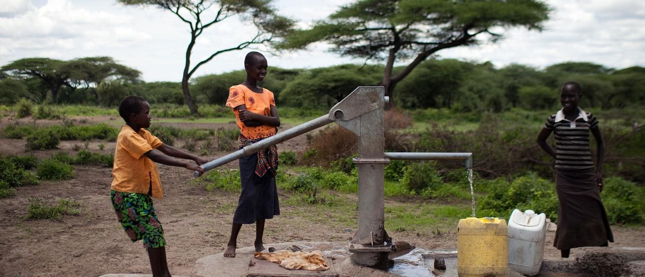 Water - a vital community resource  Young girls pump water from a well in Kiwanja Village, Isiolo County, Kenya. Photo credit: USAID/Nichole Sobecki