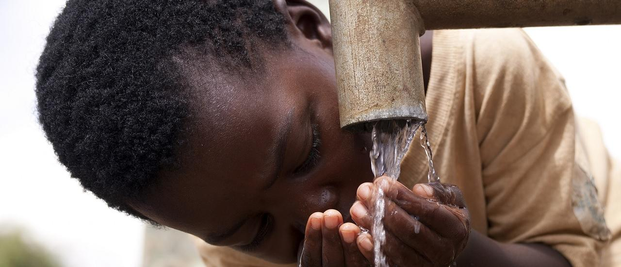 Boy Drinking Water in Malawi; Credit: Amos Gumulira, Feed the Children