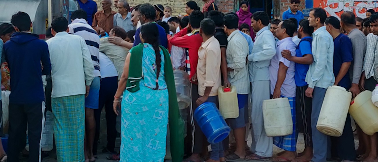 Waiting in line for water should be a thing of the past, not a portent of the future. Photo credit: Shutterstock