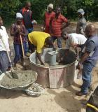 WASH entrepreneurs receive training in water pump construction. Photo credit: Global Communities Liberia