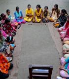"Salina Khatun, a 23-year-old Bangladeshi woman, last right, known as Tattahakallayani or Info Lady, sits with a group of Bangladeshi girls, aged between 12 and 17, hold courtyard meeting to teach about menstruation, reproductive health, HIV/AIDS and use of contraceptives at Saghata, a remote impoverished farming village in Gaibandha district, 120 miles (192 kilometers) north of capital Dhaka, Bangladesh. Dozens of Healthcare Providers known as ""Info Ladies"" bike into remote Bangladeshi villages with laptops"