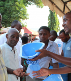 A community in Tanzania learns about SATO latrine pans. Photo credit: USAID/Tanzania