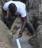 A TEPAC measures free chlorine residual in water sample from a rural drinking water system. Credit: CDC Foundation