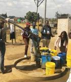 Andrea Martinsen of the CDC pumps water for a team of field staff who are testing free residual chlorine (FRC) at hands pumps fitted with inline chlorinators. Photo credit: CDC