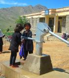 Girls pump water in the Kohband district of Afghanistan's Kapisa province. Photo credit: UNICEF Afghanistan