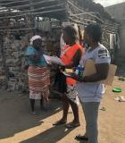 A WASH rapid response team in Dondo provides hygiene education, certeza, soap, and IEC materials to communities. Photo credit: CDC