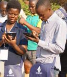 Data technicians in the Manica province of Mozambique at a training to learn how to use the new m-SINAS tablets for mobile data collection under the IWED Mozambique program. Photo Credit: ENGIDRO