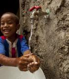 A boy in Cabo Verde washes his hands. Photo credit: MCC
