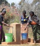 Women draw water from a public water point, one of many that is managed by community water supply organizations and supported, constructed or rehabilitated in partnership with the USAID/WARIDI activity. Photo credit: Leif Kindberg