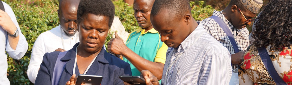 Data technicians in the Manica Province of Mozambique at a training to learn how to use the new m-SINAS tablets for mobile data collection. Photo credit: IWED Mozambique/ENGIRDO